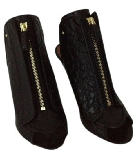 Preload https://item5.tradesy.com/images/givenchy-black-zip-front-croc-sold-out-never-worn-bootsbooties-size-us-7-regular-m-b-5939-0-0.jpg?width=440&height=440