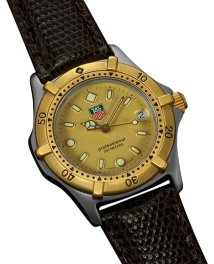 Preload https://item1.tradesy.com/images/tag-heuer-gold-professional-2000-mens-midsize-diver-stainless-steel-and-18k-plated-watch-5965315-0-1.jpg?width=440&height=440