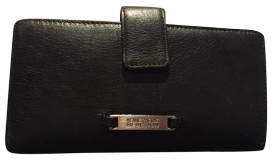 Preload https://item3.tradesy.com/images/kenneth-cole-reaction-black-wallet-5991982-0-0.jpg?width=440&height=440