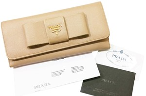 58b32ce3e582 Prada Authentic Prada Saffiano Bow Leather Bi Fold Beige Long Wallet