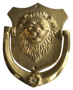 Stately solid brass lion door knocker