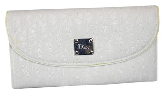 Preload https://item4.tradesy.com/images/dior-white-canvas-wallet-6023773-0-0.jpg?width=440&height=440
