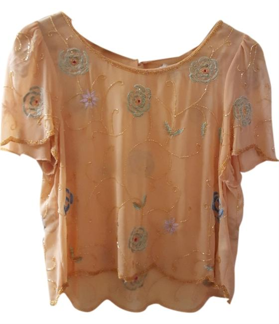 Preload https://item1.tradesy.com/images/forever-21-top-peach-6045865-0-0.jpg?width=400&height=650