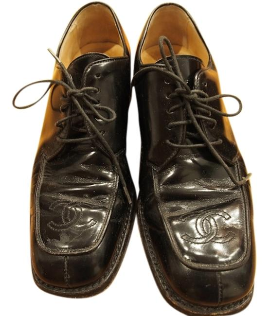 Item - Black Patent Leather Dress with The Embossed Logo. Formal Shoes Size US 6.5