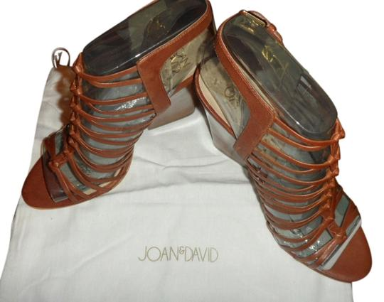 Preload https://item3.tradesy.com/images/joan-and-david-brown-victoria-strappy-heels-new-with-box-platforms-size-us-8-regular-m-b-6066847-0-0.jpg?width=440&height=440