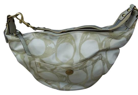 Preload https://item5.tradesy.com/images/coach-creme-and-metallic-gold-sateen-and-leather-hobo-bag-6068674-0-0.jpg?width=440&height=440