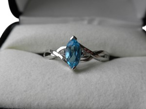 Kay Jewelers Blue Topaz ring set in White Gold