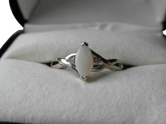 Kay Jewelers Opal ring set in White Gold