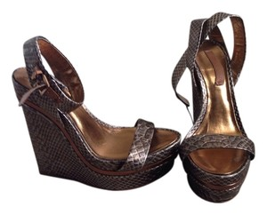 BCBGMAXAZRIA Multi color. Bronze Wedges