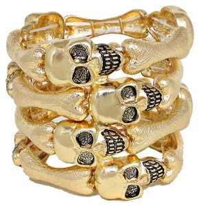 Skullz And Bones Make Up This Golden Large Cuff