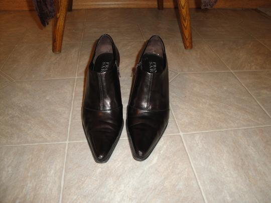 Franco Sarto brownis and some black Boots