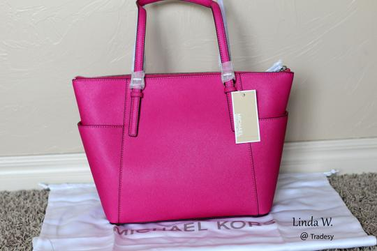 Michael by Michael Kors Saffiano Leather Logo Silver Hardware Protective Metal Feet Versatile Adjustable Dual Handles Top Closure East West Tote in Raspberry