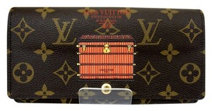 Louis Vuitton Authentic Louis Vuitton Monogram Trunk Illustre Sarah Long Wallet