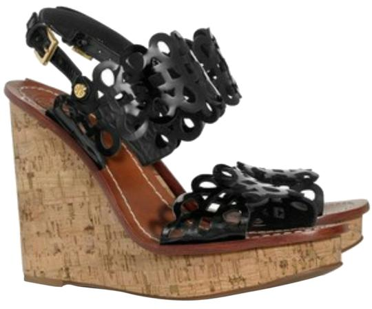 Preload https://item1.tradesy.com/images/tory-burch-black-nori-perforated-wedge-heels-in-leather-sandals-size-us-105-regular-m-b-6195670-0-0.jpg?width=440&height=440