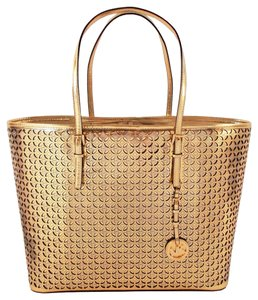 Michael Kors Flower Perforeted Travel Tote in Metallic Gold