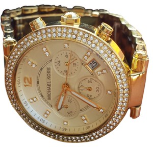 Michael Kors MICHAEL KORS ROUND WOMEN'S WATCH WITH CRYSTAL STUDS SET IN GOLD COLOR FACE. BROWN TORTOISE SHELL AND GOLD STRAP