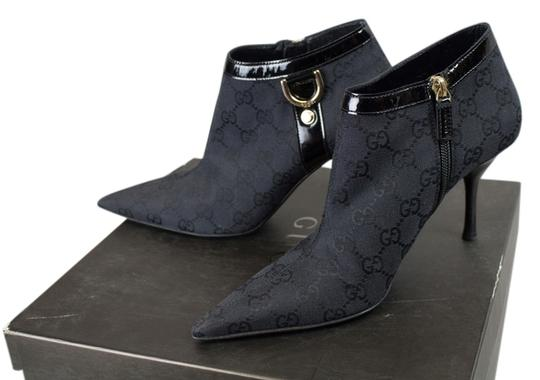 Preload https://item2.tradesy.com/images/gucci-black-signature-gg-canvas-ankle-bootsbooties-size-us-65-regular-m-b-6207751-0-0.jpg?width=440&height=440