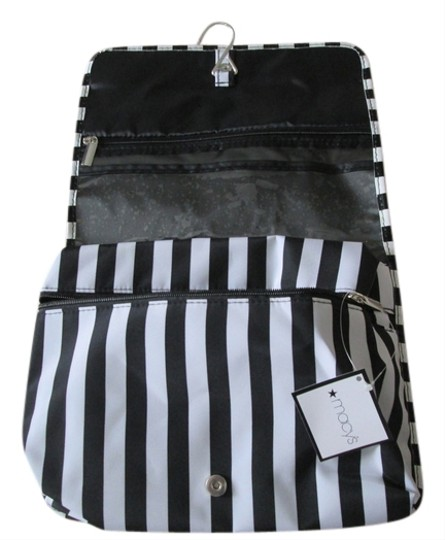Macy's Cosmetic /Travel bag with hanger. Black and white