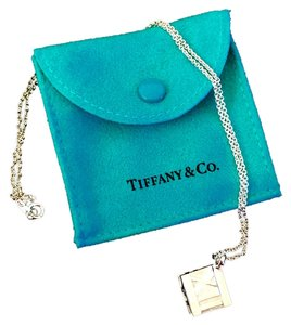 Tiffany & Co. ON SALE NOW!!! WOW!! DON'T MISS OUT ON THIS GREAT DEAL!!! Tiffany & Co. Atlas Cube Roman Numeral Pendant Necklace