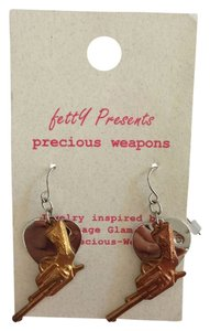 Betty Heart with Gun earrings from Urban Outfitters