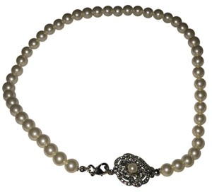 Nordstrom pearl choker with crystal flower clasp. (Look for matching bracelet in my other listings). Nordstrom Pearl Flower Necklace