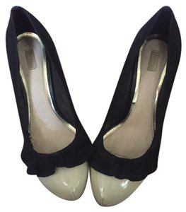 Nearly Nude Black and White Pumps