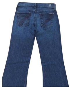 "Dojo original trouser with a wide leg opening and embroidered ""7"" back pockets. Flare Leg Jeans"