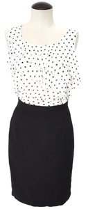 White House | Black Market Top White ruffle blouse with black polk-dots