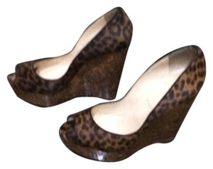 Christian Louboutin brown. leapord Wedges