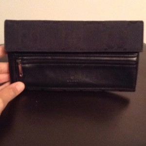 Gucci trifold wallet from the Gucci store in Las Vegas!!!! Gucci only did this big G pattern for a year back in 1999!!! Its vintage and only been used a handfull of times in great condition!!!!