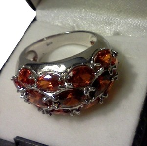 Other Fire orange opal stones set in a 825 silver ring size 8