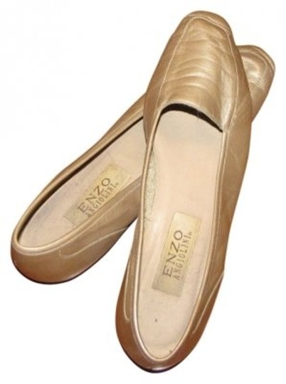 Preload https://item4.tradesy.com/images/enzo-angiolini-gold-flats-size-us-85-narrow-aa-n-6468-0-0.jpg?width=440&height=440