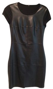 Intermix black soft and supple leather dress in great condition. Leather front and stretchy lycra back. Worn twice. Dress