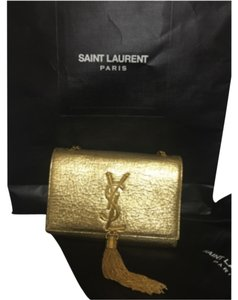 MINI CASSANDRE SAINT LAURENT TASSEL SATCHEL IN ORO GOLD LEATHER Cross Body Bag