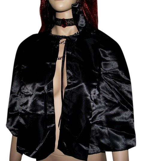 Preload https://item2.tradesy.com/images/frederick-s-of-hollywood-black-halloween-costume-vampire-ruby-red-gothic-choker-cape-and-vampire-tee-6537526-0-0.jpg?width=440&height=440