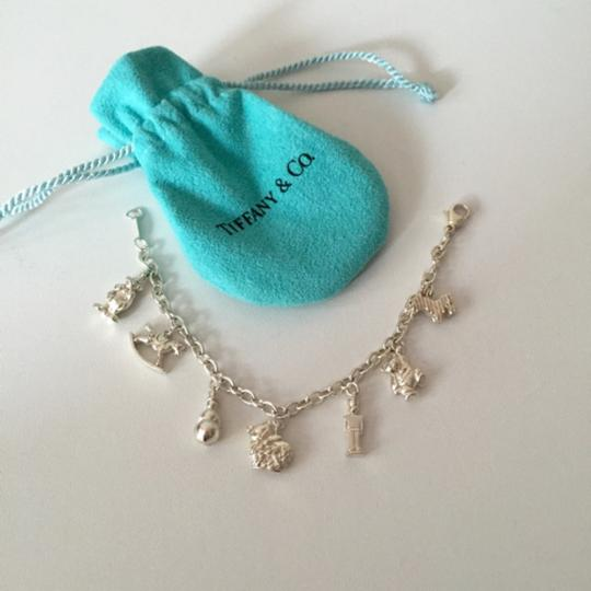 """Authentic Tiffany&co """" dream world"""" silver charm bracelet! With pouch! Rare! Seven Charms"""
