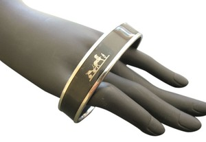 Hermès HERMES ENAMEL BANGLE IN BLACK AND SILVER PM 65