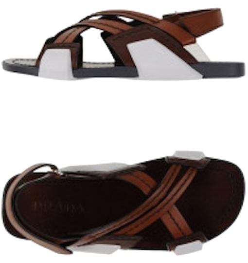 Preload https://item4.tradesy.com/images/prada-brownwhite-runway-men-leather-crisscoss-sandals-size-us-65-regular-m-b-6622408-0-0.jpg?width=440&height=440