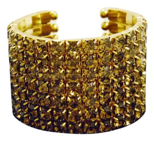 Preload https://item3.tradesy.com/images/real-collectibles-by-adrienne-golden-crystal-cuff-size-6-34-to-7-inch-bracelet-6657772-0-1.jpg?width=440&height=440