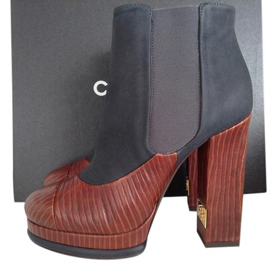 Preload https://item3.tradesy.com/images/chanel-rusty-brown-fw-201415-375-bootsbooties-size-us-75-wide-c-d-6679642-0-0.jpg?width=440&height=440