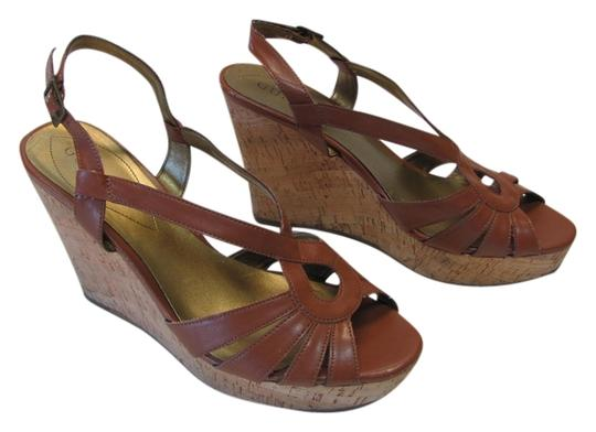 Preload https://item4.tradesy.com/images/guess-cognac-very-good-condition-m-wedges-size-us-10-regular-m-b-6680503-0-1.jpg?width=440&height=440