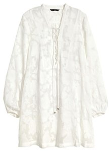 H&M short dress White/offwhite White Tunic White White Long Sleeve Long Sleeve Tunic Lace Up Tunic White Lace Up Tunic Lace Up White Mini Tunic on Tradesy