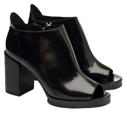 Preload https://item1.tradesy.com/images/cheap-monday-black-leather-chunky-heels-bootsbooties-size-us-10-regular-m-b-6722275-0-0.jpg?width=440&height=440