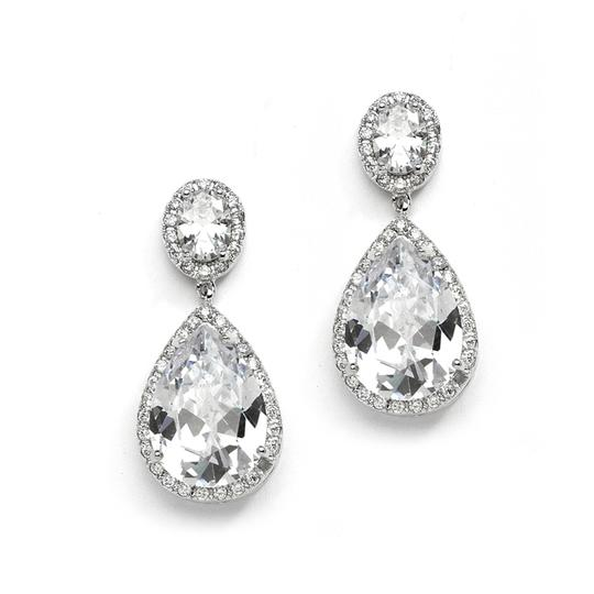 Preload https://img-static.tradesy.com/item/6737359/silver-clip-on-couture-cubic-zirconia-pear-shaped-earrings-0-0-540-540.jpg