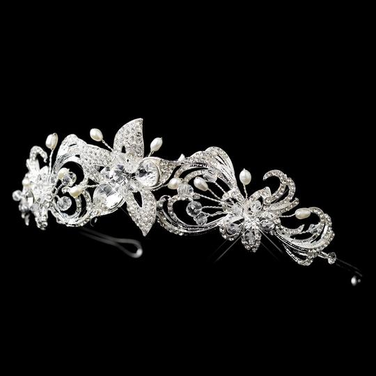 Preload https://item1.tradesy.com/images/silver-freshwater-pearl-swarovski-crystal-bead-and-rhinestone-floral-headband-tiara-679335-0-0.jpg?width=440&height=440