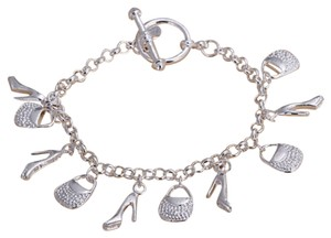 Sears NEW 7.5 in Charm Bracelet with Purses and Stilito High heels. Adorable conversation starter. Add more Charms if you like!