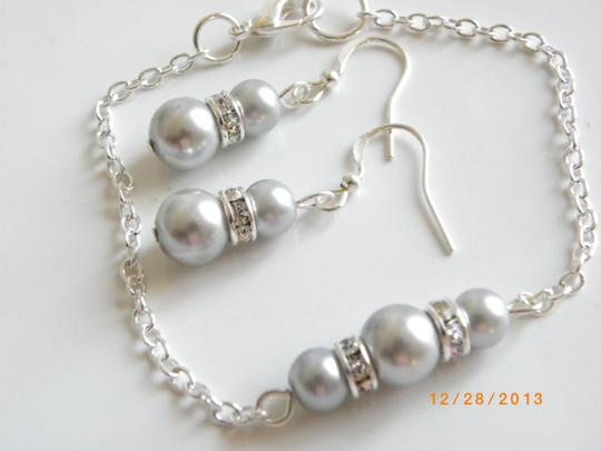 Preload https://item4.tradesy.com/images/gray-of-6-bracelets-and-earrings-jewelry-set-682003-0-0.jpg?width=440&height=440