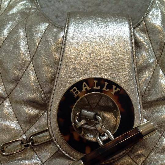 Preload https://item1.tradesy.com/images/bally-metallic-hardware-lambskin-gold-leather-hobo-bag-683250-0-0.jpg?width=440&height=440