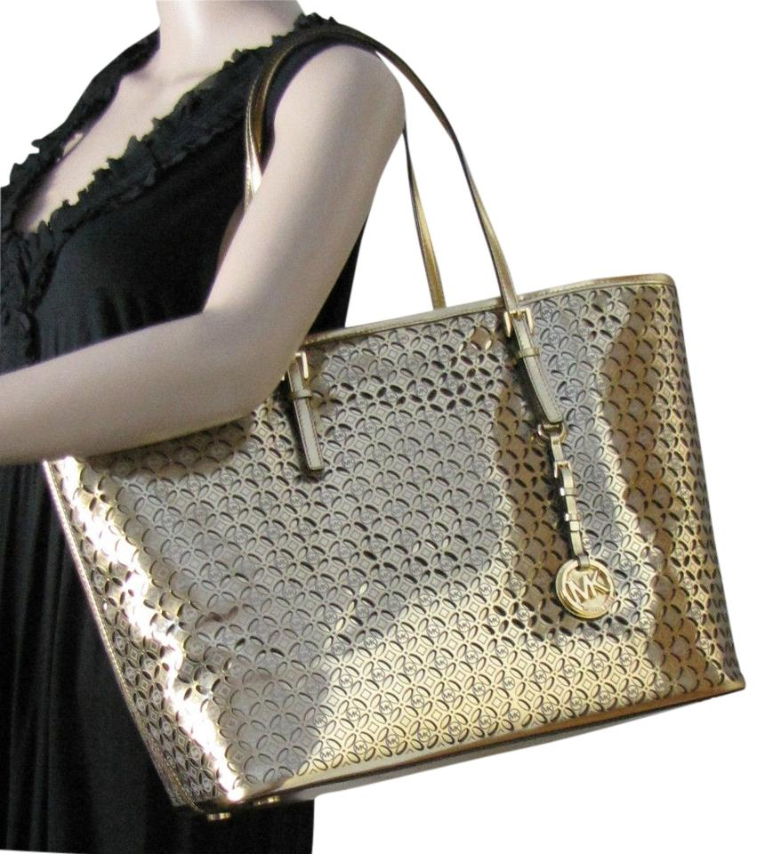 7c61ccd27b97 Michael Kors Jet Set Item Jet Set Travel Floria Flower Perforated Metallic  Leather Tote in Gold ...