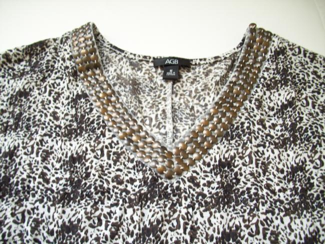 AGB Studded Neckline Short Sleeves Banded Bottom Top Animal Print